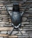 Traje parcial de la pared de piedra de armor and swords mounted on Foto de archivo libre de regalías