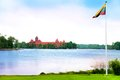 Trakai and flag of lithuania symbol castle country with the lake Stock Photography
