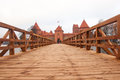 Trakai village of Karaites, Lithuania, Europe. Lithuanian landmark in late autumn. The bridge to Trakai Peninsula Castle Museum on Royalty Free Stock Photo