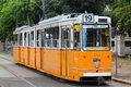 Tram in budapest hungary june people ride orange it is part of bkk public transport system which serves billion annual Royalty Free Stock Image