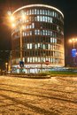 Tram at the intersection of streets at night Royalty Free Stock Photo