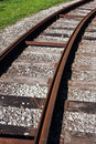 Tram rail road track disappearing around a curve Royalty Free Stock Photo