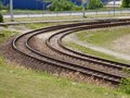 Tram rails on grass ground Royalty Free Stock Image