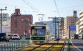 A tram running on the track in hiroshima japan Royalty Free Stock Photos