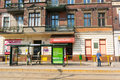 Tram stop and small stores people waiting by an in front of in poznan poland Stock Photos
