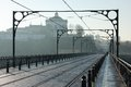 Tram tracks on dom luis i bridge porto portugal and silhouetted dome of the mosteiro da serra do pilar in the background Stock Images