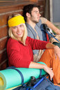 Tramping young couple backpack relax by cottage Royalty Free Stock Photo