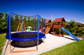 Trampoline in children's playground Royalty Free Stock Photo