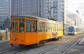 Trams on the street of milan italy december old orange tram peter witt streetcar and modern tram atm class tramway network Stock Photography