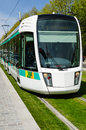 Tramway in paris france ratp the sun with green grass Royalty Free Stock Photo