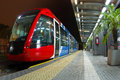 Tramway red and blue stopped at train station Royalty Free Stock Photo