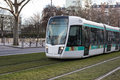 Tramway train in paris france ratp the sun with green grass and trees Royalty Free Stock Images