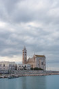 Trani romanesque cathedral reflecting in Mediterranean Sea cloudy sky Royalty Free Stock Photo