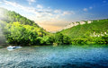 Tranquil backwater in mountains in sunny morning Royalty Free Stock Photos