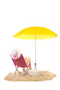 Tranquil beach with woman in chair pink and under yellow parasol isolated over white background Stock Photography
