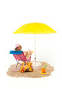Tranquil beach with woman in chair pink and under yellow parasol isolated over white background Royalty Free Stock Images