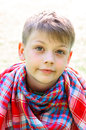 Tranquil boy portrait of with scarf outdoor Royalty Free Stock Photo