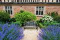 Tranquil garden seating area in the gardens of coughton court warwickshire uk Stock Images