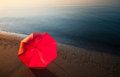 Tranquil mediterranean morning seashore beach umbrella Stock Photos