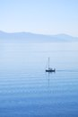 Tranquil morning sea with a sailing ship Royalty Free Stock Photo
