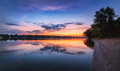 Tranquil scene with river and colorful sky with clouds at sunset Royalty Free Stock Photo