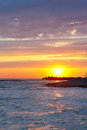 Tranquil sea sunset on a background cloudy sky Royalty Free Stock Photo
