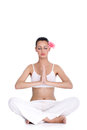 Tranquil woman meditating young in lotus position Royalty Free Stock Image