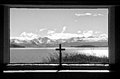 Tranquility view of lake tekapo nz from the inside of the church of the good shepherd Stock Photo