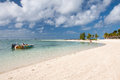Tranquill belle mare beach on mauritius – june people relaxing an beautiful maritius june in an exotic with white Royalty Free Stock Images