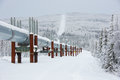 Trans alaska pipeline in winter the system taps includes the crude oil pump stations several hundred miles of feeder Royalty Free Stock Image