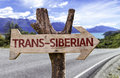 Trans-Siberian wooden sign with a railway on background Royalty Free Stock Photo