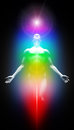 Transformation into light human body with seven energy centers and Royalty Free Stock Image