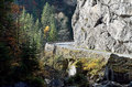 Transient mountain road winding on alpine landscape near fir forest in autumn season Stock Images