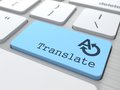 Translating concept translate button on modern computer keyboard Royalty Free Stock Images