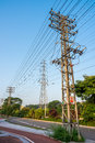 Transmission electric power poles the steel are in town Royalty Free Stock Photo