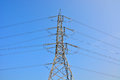Transmission lines power line on blue sky Stock Images