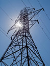 Transmission Pylon and Sun Royalty Free Stock Photo