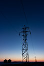Transmission Tower Silhouetted at Sunset Vertically