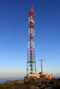Transmission tower on top of mountain a a Royalty Free Stock Photos