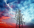 Transmission towers lightning over power station in sky Stock Images
