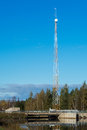 Transmitter tower by a dam Royalty Free Stock Photo