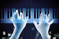 Transparency hand playing piano dark blue background Royalty Free Stock Photography