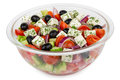 Transparent glass bowl with Greek salad isolated on white Royalty Free Stock Photo