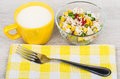 Transparent glass bowl with vegetable mix, cup of milk Royalty Free Stock Photo