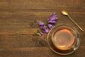 Transparent Glass Teacup And Gold Teaspoon On Rough Wood Table Royalty Free Stock Photo