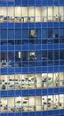 Transparent glass wall of business center with offices Royalty Free Stock Photo