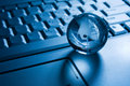 Transparent globe on a laptop  keyboard Royalty Free Stock Photo