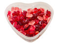 Transparent heart shape vase bowl filled with colored red heart shape jellies red bokeh background close up Royalty Free Stock Photos