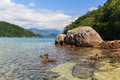 Transparent water and stones in sea near beach Cotia on island n Royalty Free Stock Photo
