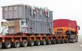 Transport of heavy, oversized loads and construction machinery Royalty Free Stock Photo